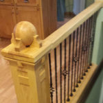 Unfinished wooden balls on a staircase railing
