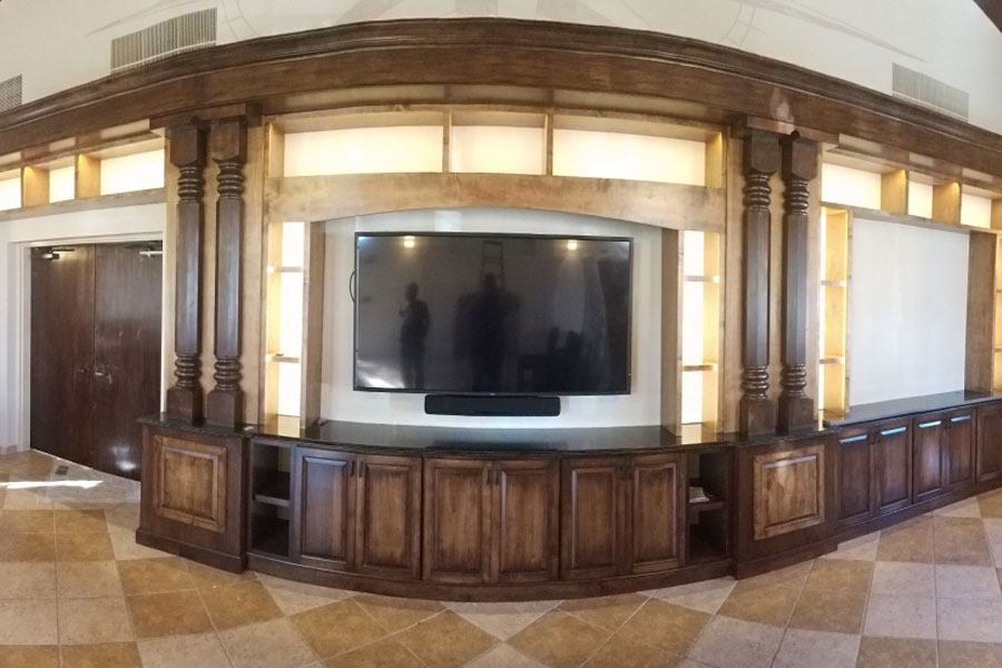 In-home theater with custom cabinetry and columns
