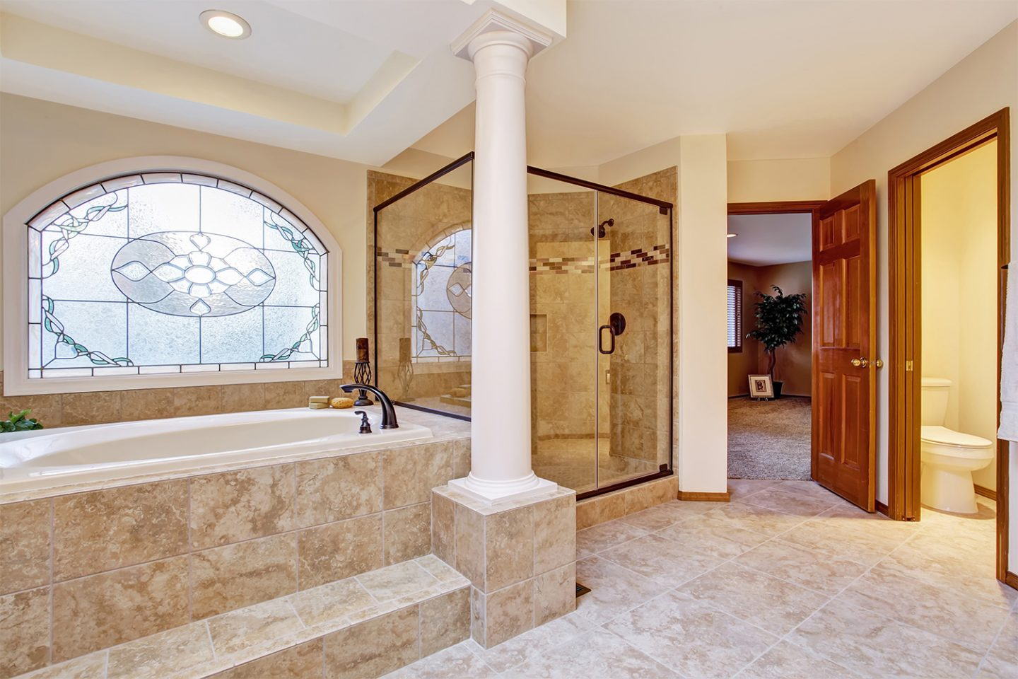 Luxury master bathroom with ornate wooden column