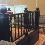 Black painted wooden balls on banister