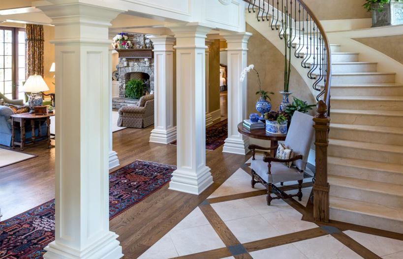 Grand entrance to home with square wood columns