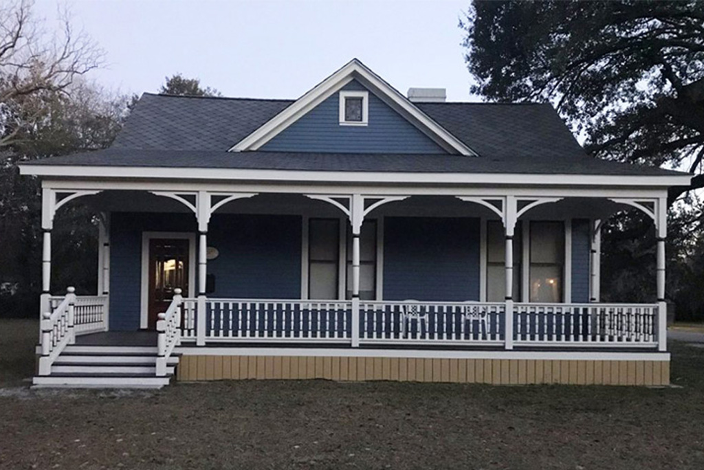 Porch posts columns on blue single story home