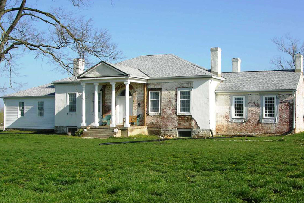 porch post columns on white mansion