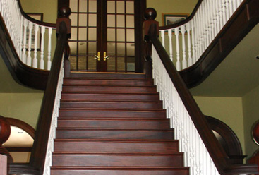 Grand staircase in home foyer