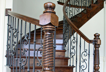 Metal spindles with wooden stairs