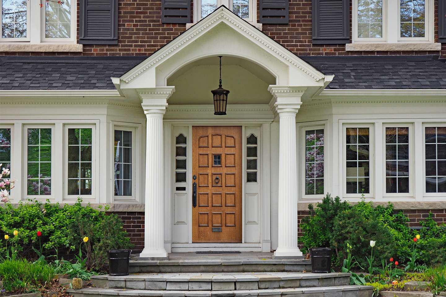 Traditional porch posts on beautiful brick home
