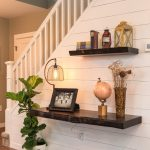 Floating shelves in the entry way of a home